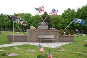Veteran monument with flags waving