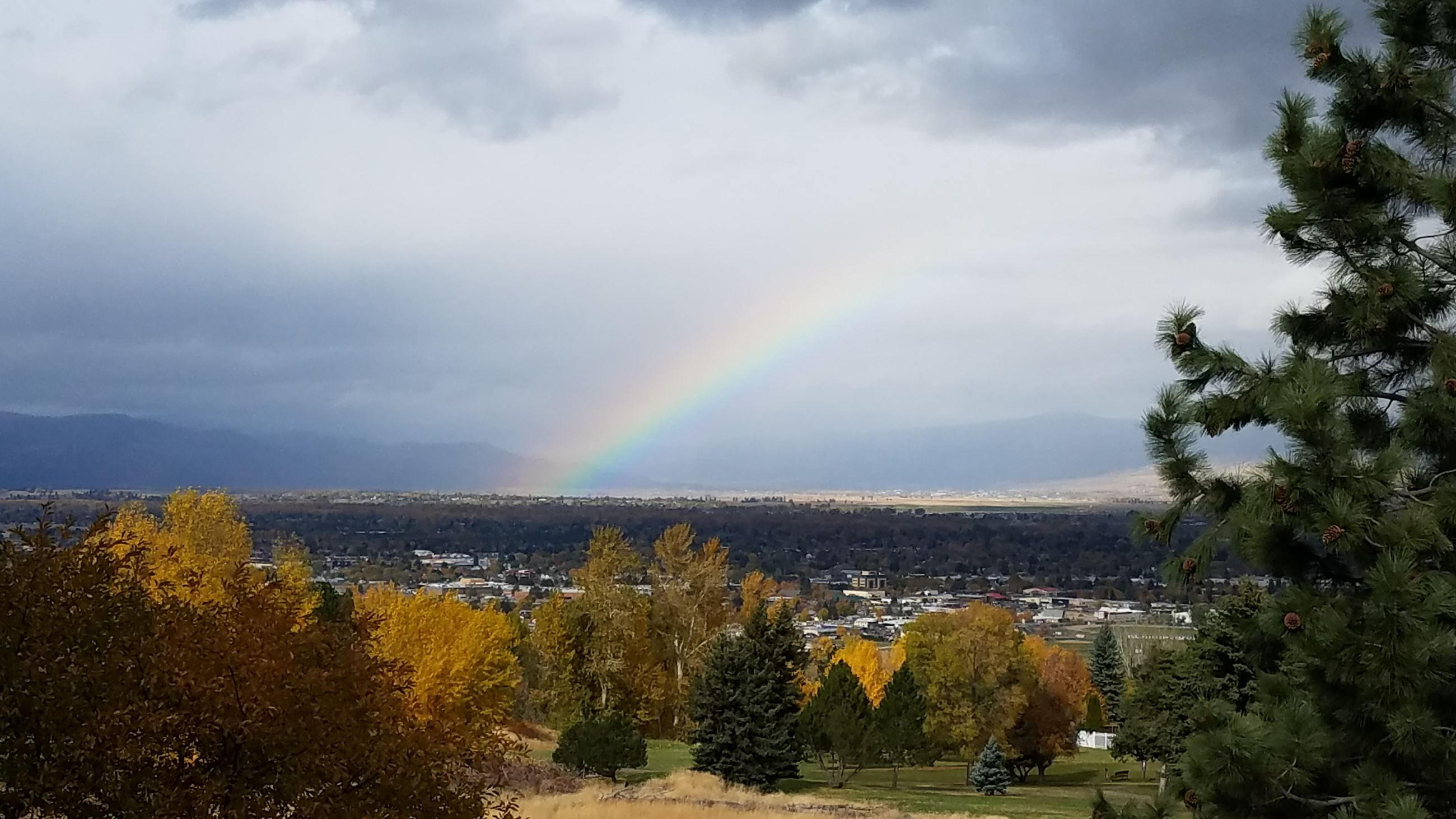 View of Missoula Valley with rainbow in the sky