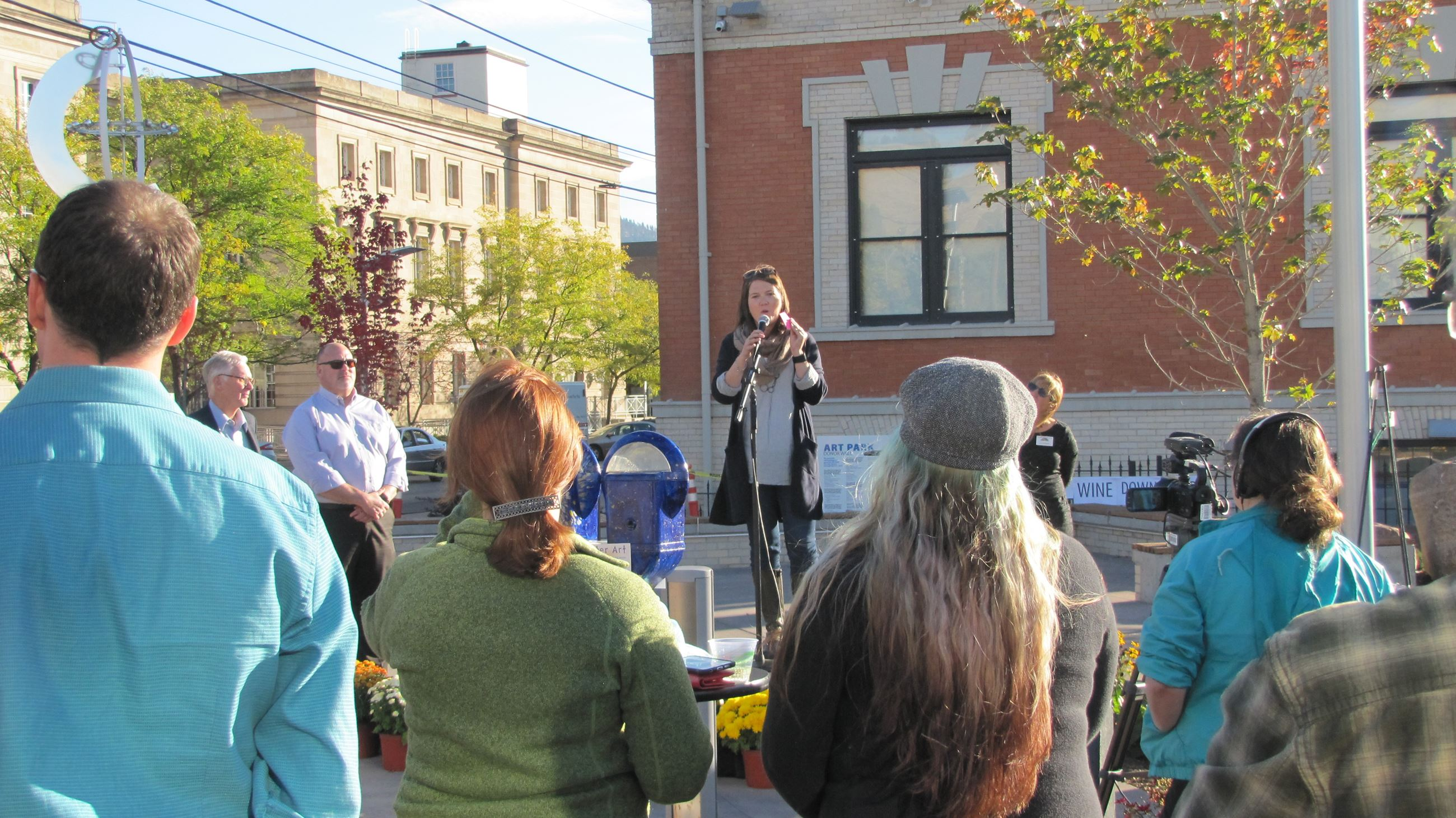 Allison Mouch speaking to the crowd