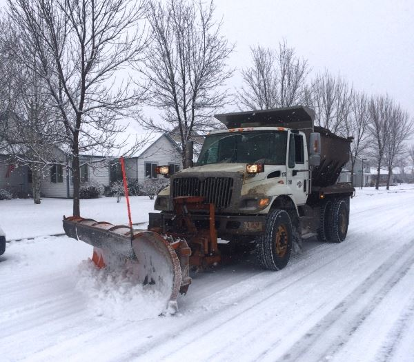 Snowplow clearing a residential street