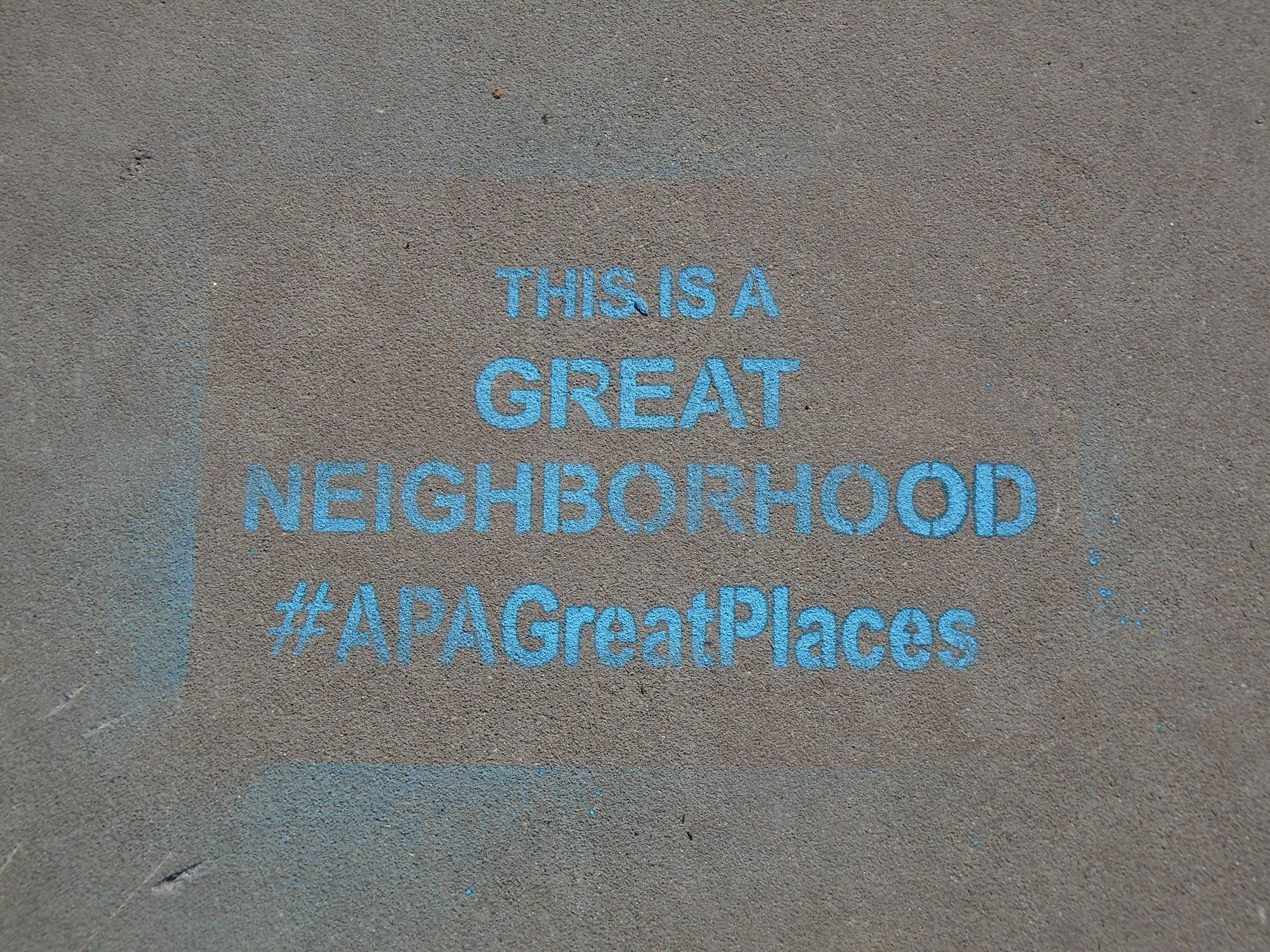 This is a Great Neighborhood #APAGreatPlaces stenciled on sidewalk