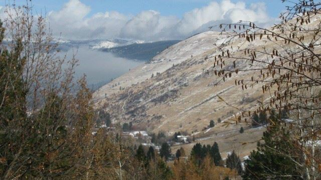 View of Missoula and mountains with light snow