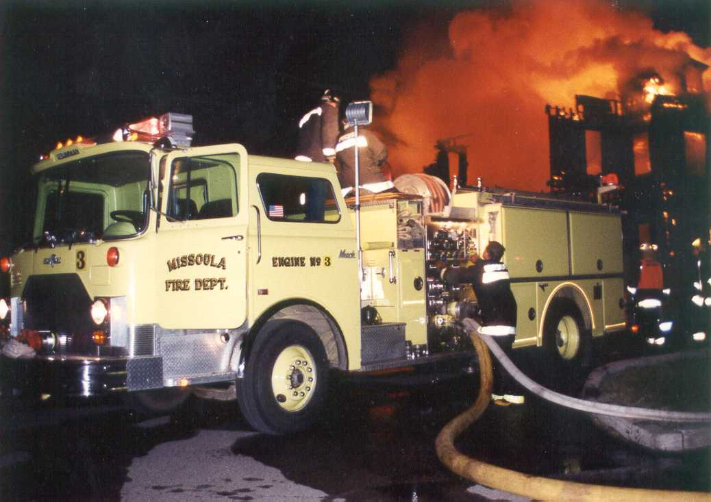 Missoula Fire Engine in front of the Missoula mansion, ablaze in the background on June 11, 1992.